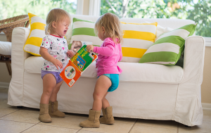 toddlers by couch