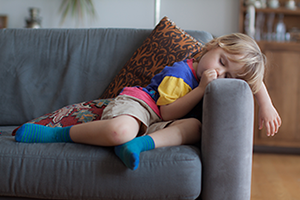 child asleep on the couch