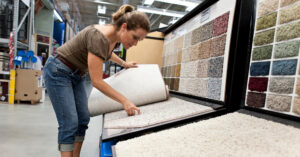 a woman looks at carpet samples
